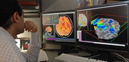 Brain images - researcher analyzes FMRI brain images nimh.nih.gov